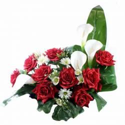 Jardinera flors artificials cementeri capolls rojos