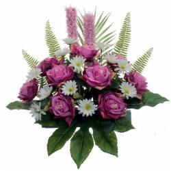 Jardinera cementeri flors artificials roses i margerides
