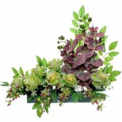 Jardinera cementeri flors artificials orquidies verdes